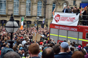 Corbyn speaking to large crowd from top of fire engine