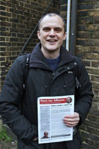 Photo of Ian Allinson holding campaign leaflet