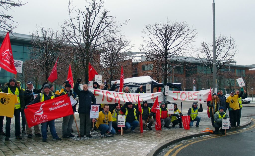 """Ian Allinson with big group of pickets outside Fujitsu Manchester. Banner reads """"Fighting 4 jobs"""""""